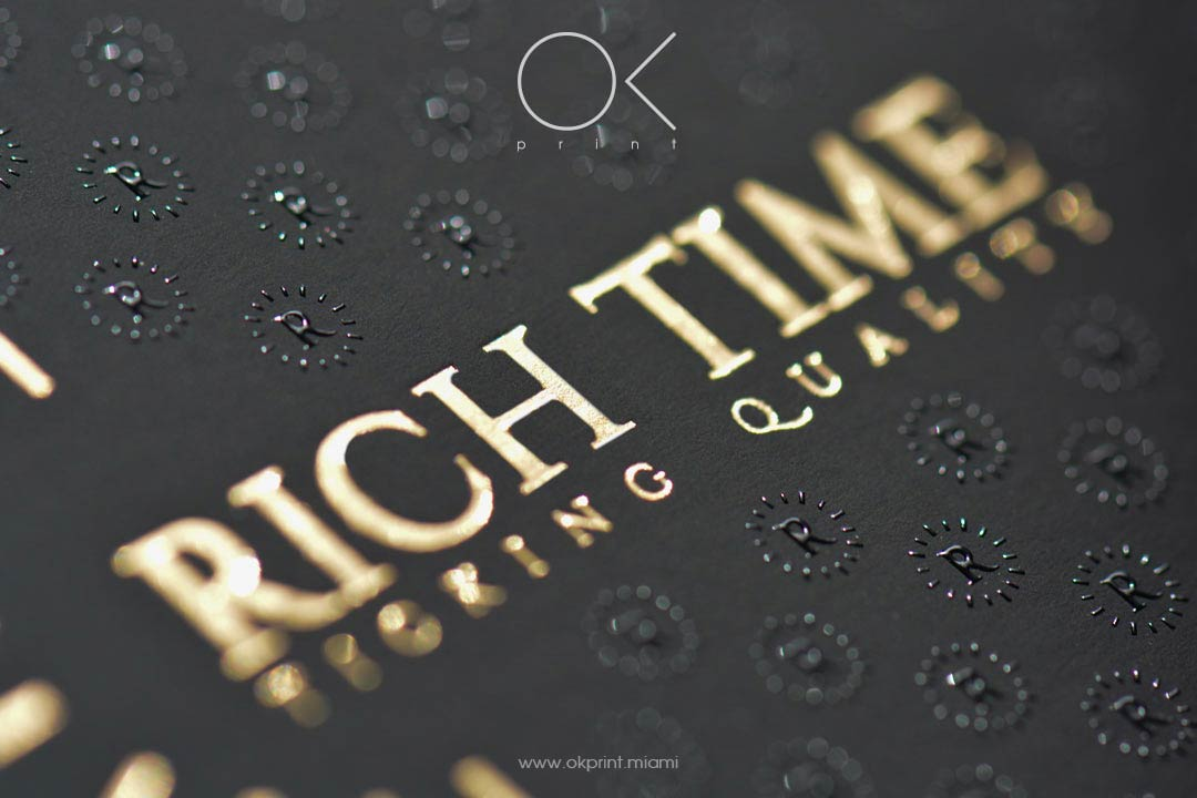 Luxury thermography business cards with gold foiling and
